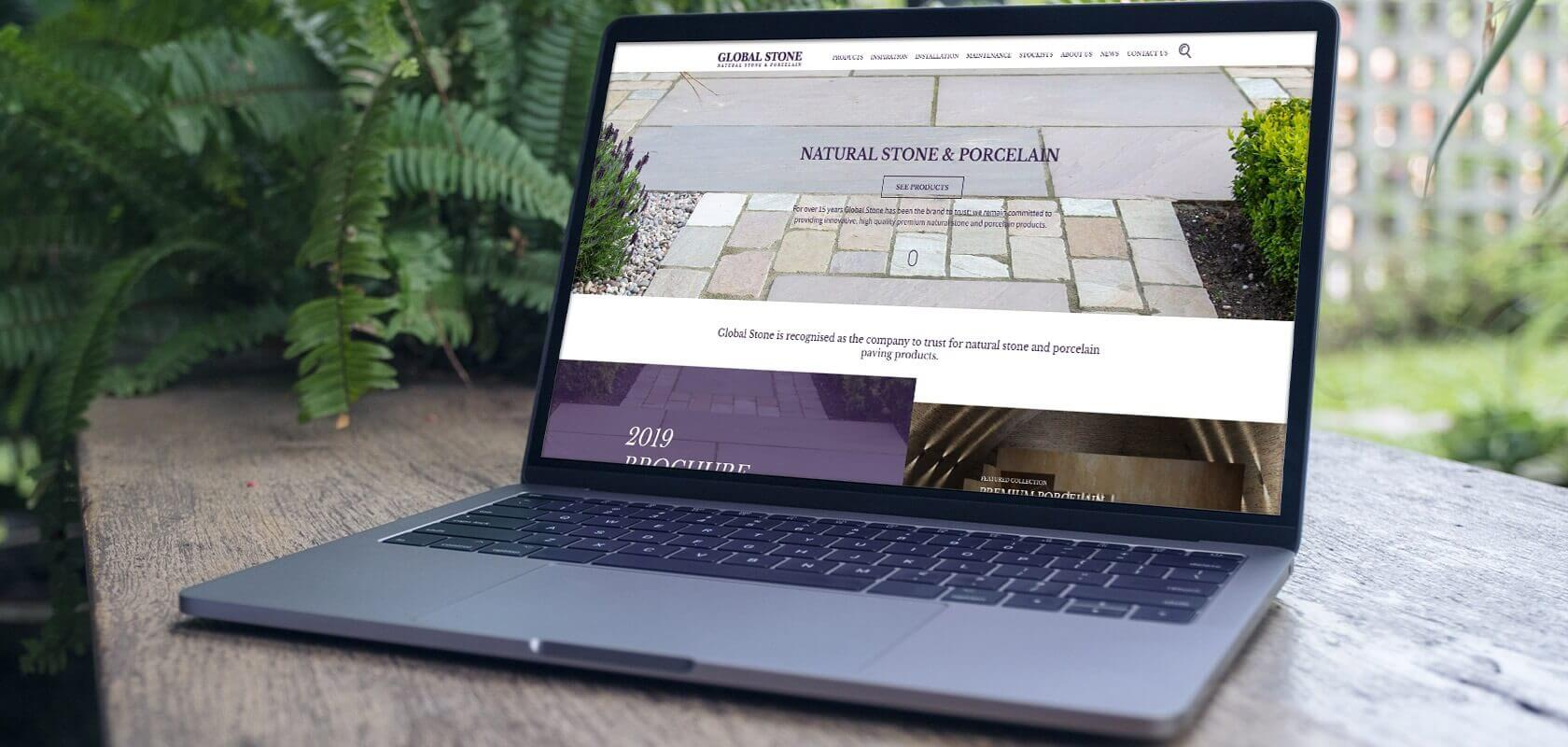 Global stone website on laptop